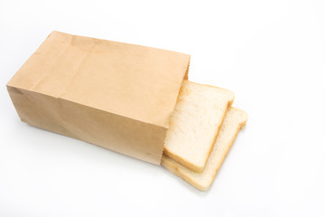 Slice toast bread in paper bag on white background