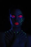 Glowing Woman Wearing UV Cosmetics Under Black Light poster