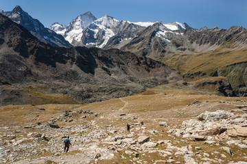 hikers descending in Val d'Anniviers in Swiss Alps
