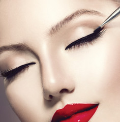 Makeup. Perfect Make-up Applying closeup. Eyeliner