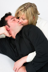 Young Couple Man Woman Engaged Laying Down Kissing Embraced