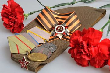 Soviet military cap with red flowers, Saint George ribbon, medal