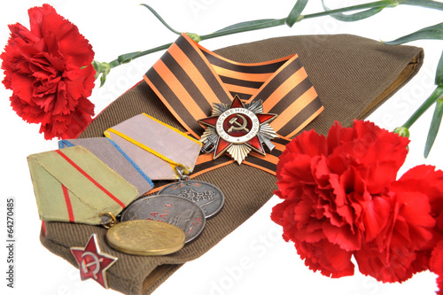 Soviet military cap, red flowers, Saint George ribbon, medals of