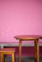 Background with wooden table and grunge pink wall