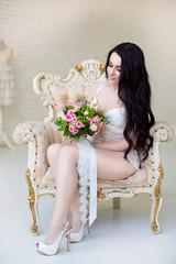 Beautiful young bride with wedding bouquet. Last preparations fo