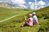 Travelers on the hill. Melchsee-Frutt, Switzerland