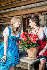 Two Woman wearing austrian Dirndl