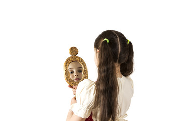 Young girl looking in the mirror