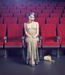 girl in an empty cinema