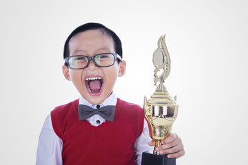 Excited student boy holding trophy - isolated