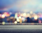 Fototapety Asphalt road and blurred modern city