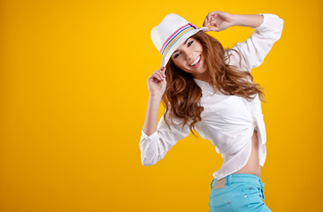 very nice and sexy spring  brunette girl with hat in a yellow ba