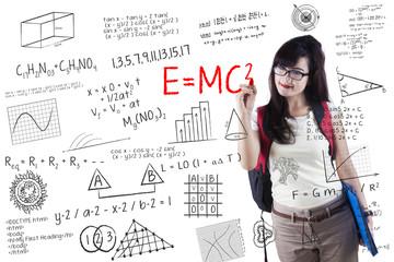 Female student writes formula