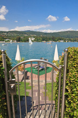 Log onto the private beach. Lake Worthersee Velden . Austria