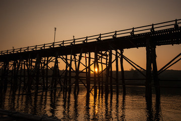 Sunset at the longest wooden bridge and floating Town in Sangkla