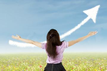 Success businesswoman with upward arrow