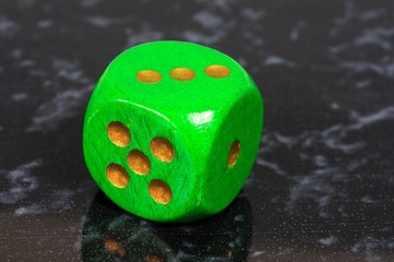 Green dice © Arena Photo UK