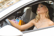 blond elegant girl driving for shopping