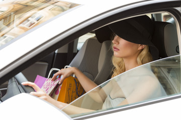 pretty girl with hat driving