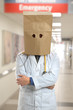 Doctor Wearing Paper Bag Over Head in Hospital