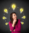 Young woman thinking with lightbulb circulation around her head