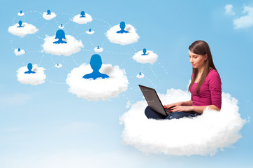 Young woman sitting in cloud with laptop