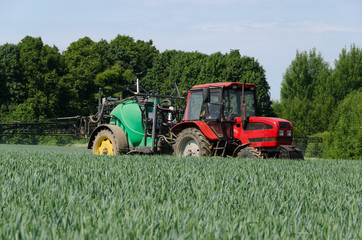 farm machinery tractor long sprayer work in field
