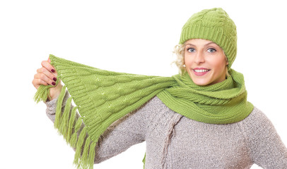 Beautiful woman holding her scarf