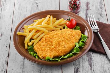 breaded chicken schnitzel fries