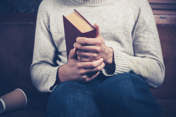 Nervous young man with book