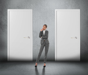 Businesswoman choosing right door