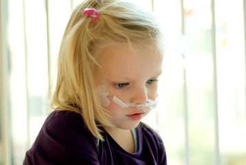 child at hospital with oxygen mask