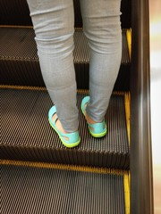 standing on escalator