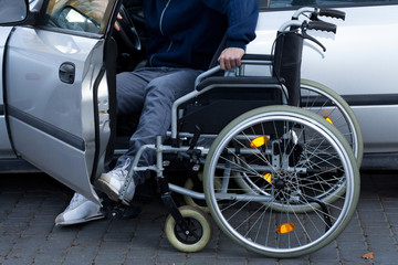 Disabled man preparing to drive