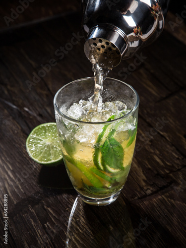 Pouring a cocktail into glass