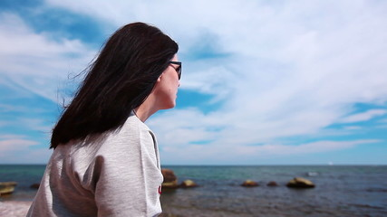 a young woman looks at the seaside