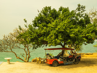 Tricycle under tree at Sichang island,Thailand