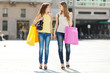Two young women shopping in the city