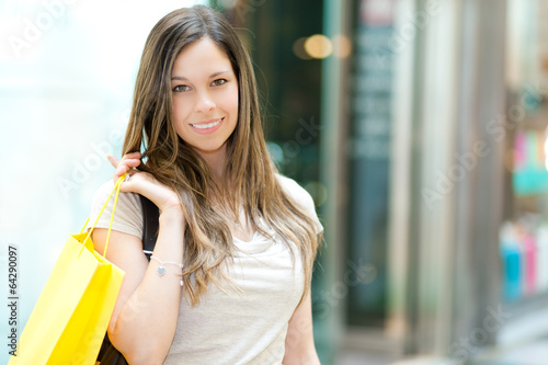 Young smiling woman shopping in a mall
