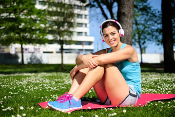 Relaxed happy fitness woman resting
