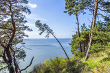 romantic steep cliff with lake - 64291451