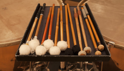Closeup  of mallets.   drum set