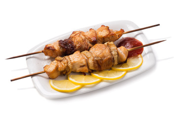 Skewers of chicken meat isolated on white background