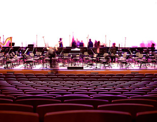 Empty chairs stand on stage in  Concert Hall