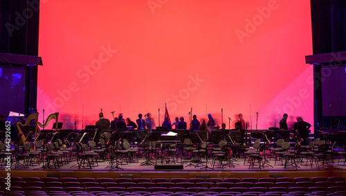 Fotobehang Uitvoering Empty chairs stand on stage in Concert Hall