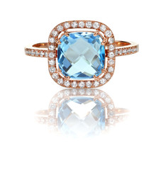 Beautiful Blue Topaz and diamond Rose Gold Halo Ring