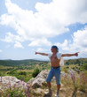 Man standing on a hill and gesticulates