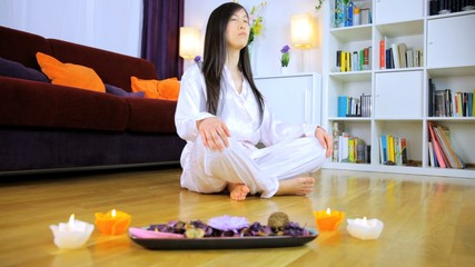 Meditating at home with candles