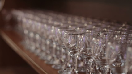 Many wineglasss rows in bar