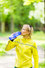 Female runner drinking water